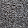 Old charred roofing background - Stock Photo