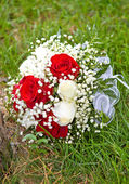 Wedding bouquet in the grass — Stock Photo