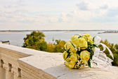 Wedding bouquet on a background of the river — Stock Photo
