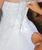 Tightening a corset to the dress — Stock Photo
