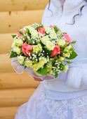 Hand with a wedding bouquet — Stock Photo