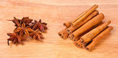 Cinnamon and anise on a wooden background — Stock Photo