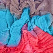 Bunte textile hintergrund falten — Stockfoto