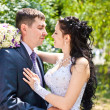 Stock Photo: Bride and groom look at each other