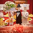 Stock Photo: Wedding champagne and bouquet on decorated table