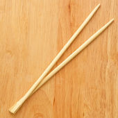 Chinese sticks on a wooden board — Stock Photo
