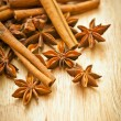 Vanilla sticks and star anise on a wooden board — Stock Photo