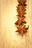 Asterisks anise on a wooden board — Stock Photo