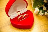 Velvet box with wedding rings — Stock Photo