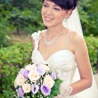 Portrait of a beautiful smiling bride — Stock Photo