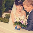 Bride and groom outdoor wedding portraits  — Stock Photo