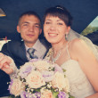 Portrait of happy newly wed couple in car — Stock Photo #29393207