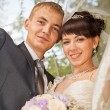 Young wedding couple - freshly wed groom and bride posing — Stock Photo