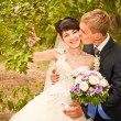Happy young bride and groom on their wedding day — Foto Stock