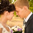 Happy young bride and groom on their wedding day — Stock Photo