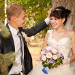 Happy young bride and groom on their wedding day — ストック写真