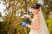 Portrait of a beautiful smiling bride — Stok fotoğraf