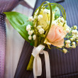 Wedding boutonniere on his jacket — Stock Photo