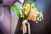 Wedding boutonniere on his jacket — Stock Photo