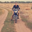 Foto Stock: Mwith motorcycle on country road