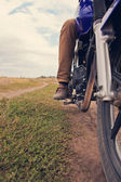 Leg men on a motorcycle close-up — Stock Photo