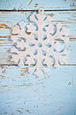 Snowflake on a wooden background — Stock Photo