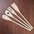 Kitchen utensils on a wooden background — Stock Photo