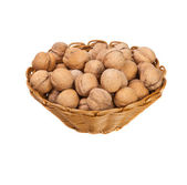 Walnuts in a wicker basket on a white background — Stock Photo