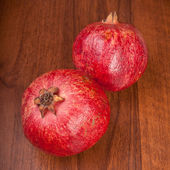 Pomegranate on wooden background — Stock Photo
