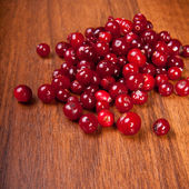 Cranberries on a wooden background — 图库照片