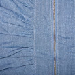 Stock Photo: Zipper on denim background