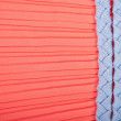 Stock Photo: Woven textile belt on red silk background
