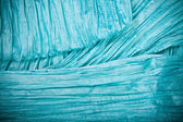 Textiles turquoise background with folds — Stock Photo