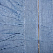 Zipper on denim background — Stock Photo