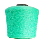 Reel with turquoise yarn on white background — Stock Photo