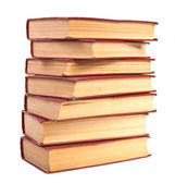 Stack of old books with yellowed pages on white background — Stockfoto