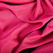 Red textile background with folds — Stock Photo