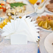 Paper napkins on decorated table — Stock Photo