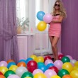 Bright girl with balloons — Stock Photo #22449023