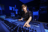 Man using a Sound Mixing Desk — Foto Stock