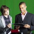 Stock Photo: Presenter and Floor manager in TV Studio