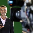 Presenter in TV Studio with foreground camera — Stock Photo #21687627