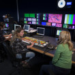 Crew in TV Broadcast Gallery - Stock Photo
