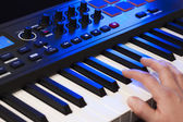 Hand Playing a MIDI Keyboard — Stock Photo