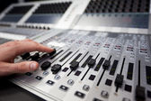 Hand on a sound fader in Television Gallery — Stock Photo