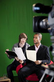Floor Manager briefing Presenter in TV Studio — Stok fotoğraf