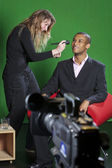 Television presenter and make-up artist on TV set — Stock Photo