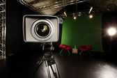 Television Camera Lens in Green screen studio — Stockfoto