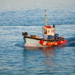 Stock Photo: Fishing trawler at sea