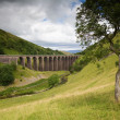 Viaduct in English Countryside on Cloudy Day - Stock Photo
